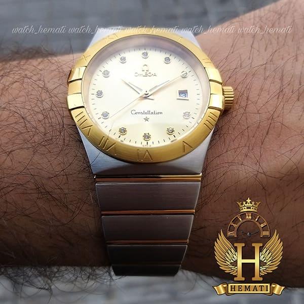خرید ، قیمت ، مشخصات ساعت مچی مردانه امگا کانسلیشن نقره ای با دورقاب و صفحه طلایی رنگ