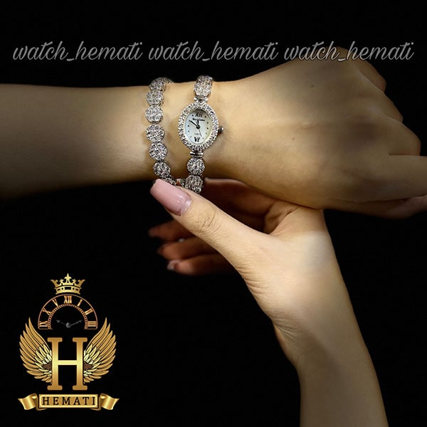 خرید ارزان قیمت ساعت زنانه رویال کرون Royal crown 1516 نقره ای دو دور بند مدل فلاور نگین سواروسکی های کپی
